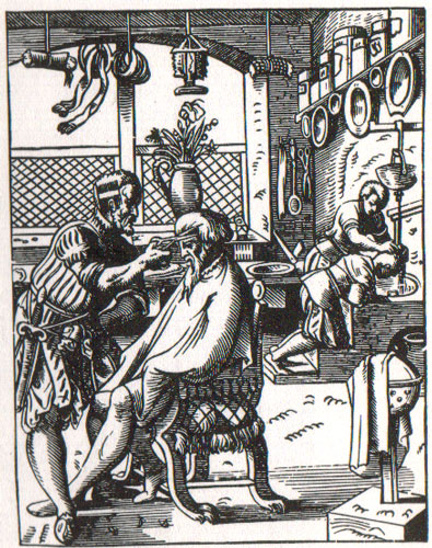 c16th - Woodcut shows shampooing and haircutting in a barber's shop