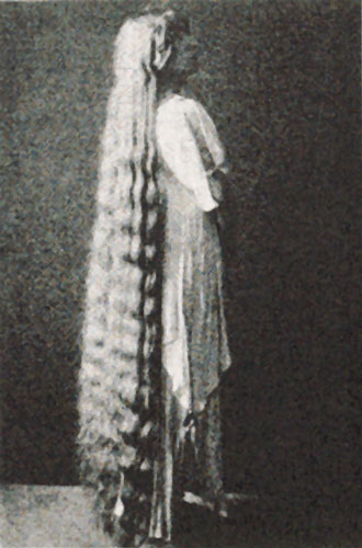 c20th - Long haired lady dating from early 1900s